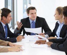 Group Of Business People Having Meeting In Office